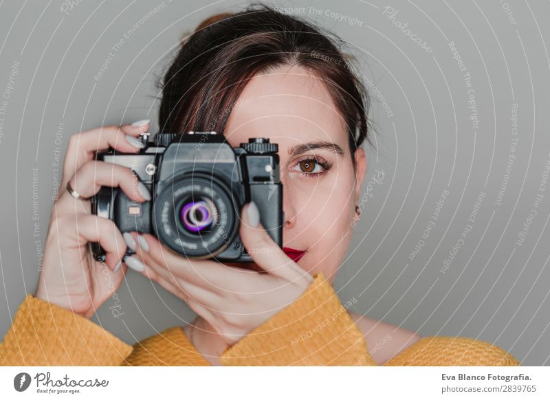 close up portrait of a young woman holding a camera Lifestyle Happy Beautiful Face Leisure and hobbies Work and employment Camera Human being Woman Adults Art
