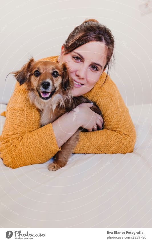 young woman and her cute dog on bed Lifestyle Joy Happy Beautiful Relaxation Bedroom Woman Adults Family & Relations Friendship Animal Pet Dog Kissing Laughter