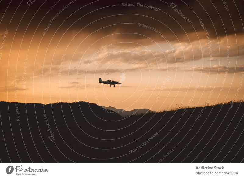 Silhouette of plane in air Landscape Airplane Mountain Sunset Clouds Majestic Tourism
