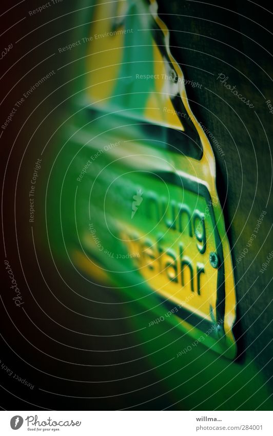 danger in delay Warning sign Warning label Dangerous Sign Characters Text Signage Yellow Green Risk Caution Danger High Voltage Colour Undulating Smeared