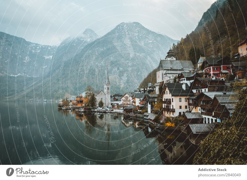 Cityscape on tranquil shore in mountains Mountain Lake Coast Cold Nature Harmonious Landscape