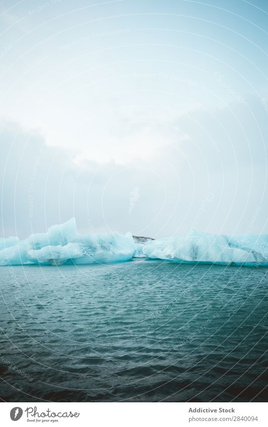 Two ice blocks in water Ice Floating Ocean Blue Nature Iceberg Water Vacation & Travel polar Cold The Arctic White Winter Environment Landscape Climate Snow