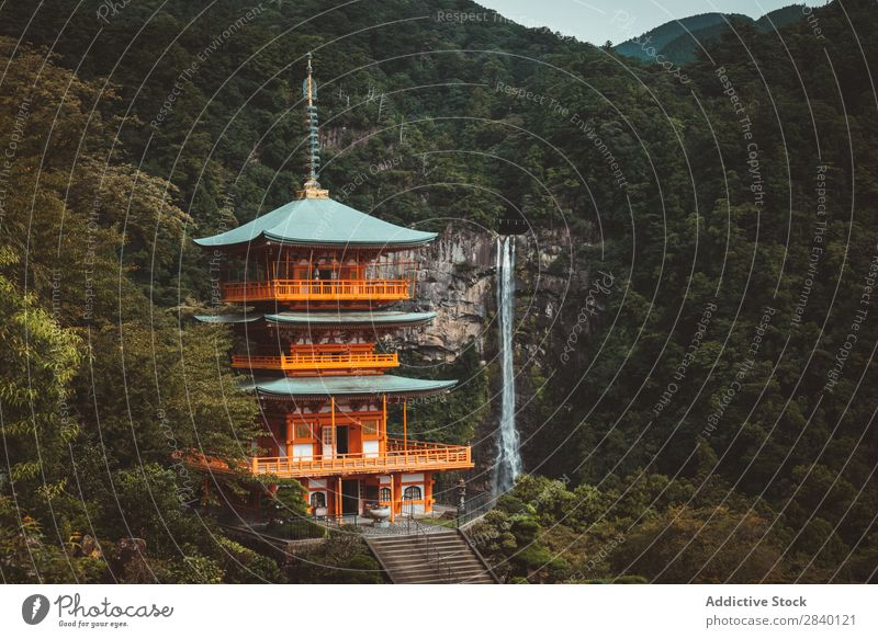 Traditional Asian tower in nature Building asian Nature Green Vantage point Mountain Hill Cliff Rock Plant Beautiful Natural East Tower oriental eastern Pagoda