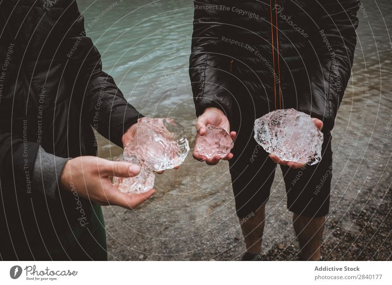 Anonymous people holding ice pieces Human being Ice Piece Crystal Traveling Hold Mountain Glacier Winter Natural Frost Transparent Formation The Arctic