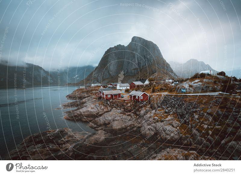 Village on rocky shore. Hamnoya Rock Coast Mountain Landscape Remote Nature Vacation & Travel