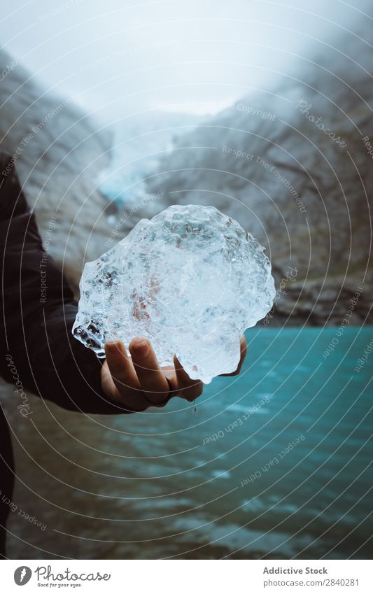 Anonymous person holding ice piece Human being Ice Piece Crystal Traveling Hold Mountain Glacier Winter Natural Frost Transparent Formation The Arctic