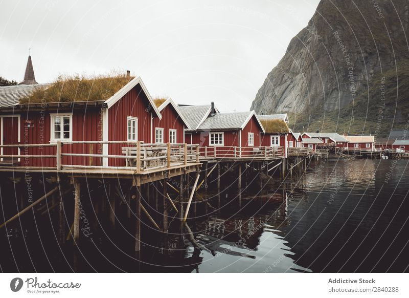Small houses on lakeside in mountains House (Residential Structure) Range Lake Mountain Landscape Rural Reflection Settlement Village Nature Vantage point