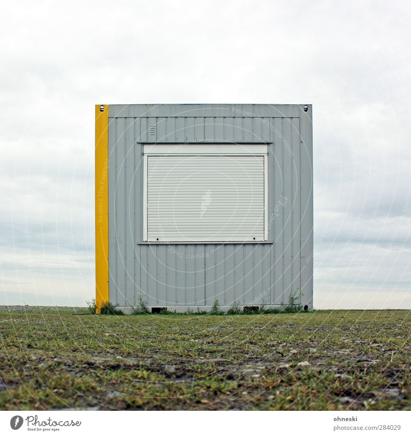 nothing going on Hut Building Site trailer Container Facade Window Venetian blinds Gray Reluctance Loneliness Horizon Colour photo Exterior shot Deserted