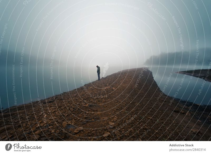 Anonymous person on misty shore Human being Coast Fog Calm Landscape Vacation & Travel Morning Silhouette Horizon Lake Tourism Peaceful silence Idyll Nature