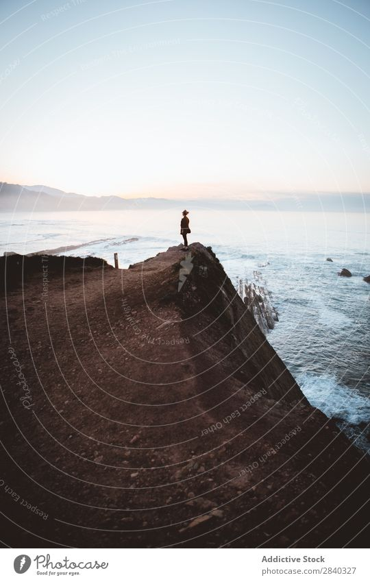 Person on cliff on seashore Human being Coast Calm traveler Landscape Vacation & Travel Silhouette Horizon Ocean Tourism Peaceful silence Stand Idyll Cliff