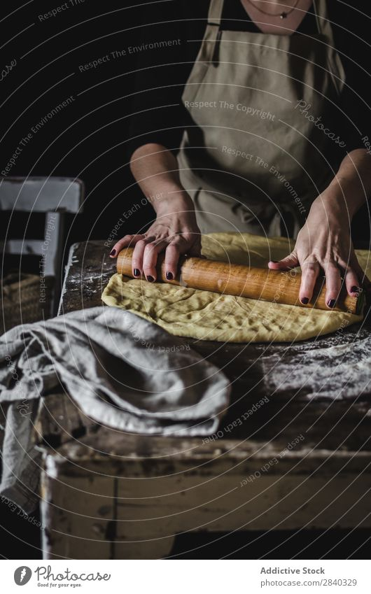 Crop woman kneading dough Human being Cooking Dough Rustic Flour Food rolling Pin chef Bakery Baked goods Table Make Bread Ingredients Preparation Home-made Raw