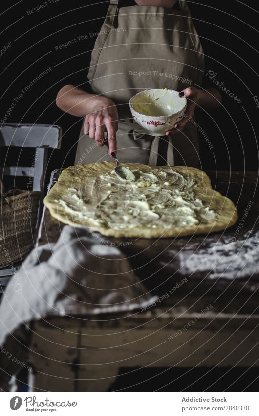 Woman putting stuffing on dough Human being Cooking Dough knead Rustic Flour Food Filling Bowl Putt chef Bakery Baked goods Table Make Bread Ingredients