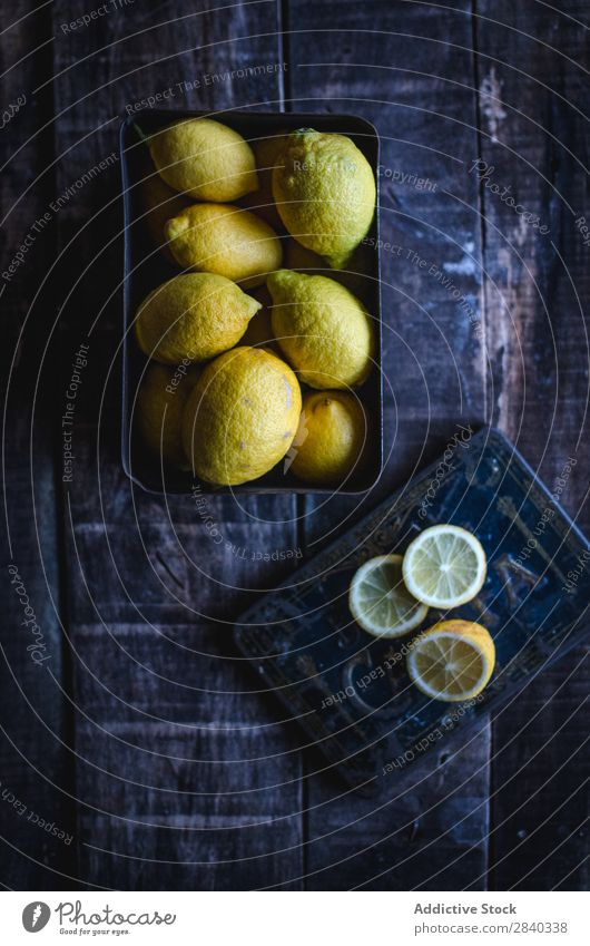 Tasty lemons on wooden table Lemon Fresh Fruit Food Healthy Yellow Sweet
