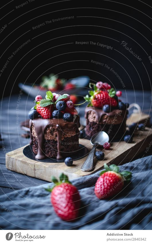Sweet cakes decorated with berries Baked goods Rustic Delicious Cake Berries served Chocolate appetizing Dessert Food Fresh Tasty Home-made Gourmet Bakery Snack