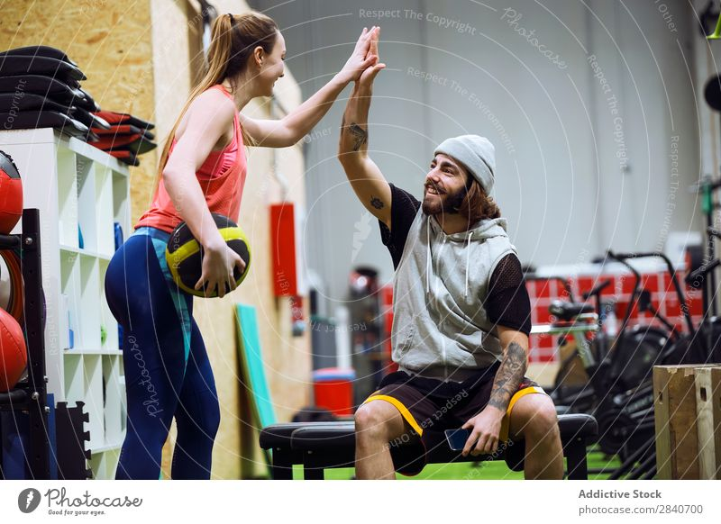 Sporty people cheering themselves in gym Human being Gymnasium workout Athletic Fitness Practice Lifestyle high five Applause Sports Healthy Sportswear Action