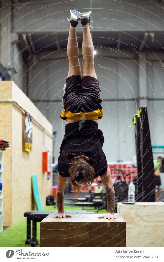 Man standing upside down in gym Gymnasium workout Athletic Fitness Practice Lifestyle on hands Stand Sports Healthy Sportswear Action Human being Beautiful Body
