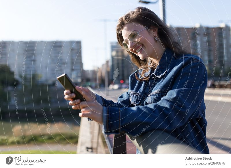 Smiling woman on road with phone Woman Walking Street Crossing Town Sunglasses Happy
