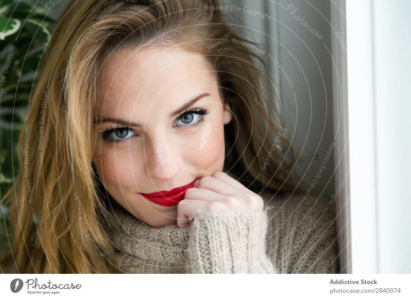 Beautiful young woman looking at camera at home. Blonde Eyes Red Lips Woman Youth (Young adults) Adults Sweater indoor Home Girl Smiling only 1