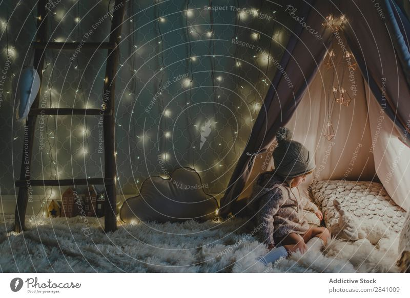 Toddler playing in an illuminated tent Christmas & Advent Girl Strange Tent Small Fairy tale White Entrance Infancy Joy imaginary discovering entering