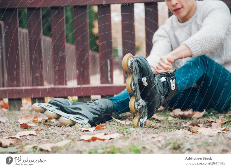 Young boy in the park Adults Autumn Attractive Background picture Boy (child) Brunette Easygoing Cool (slang) Cute Fashion Expression Expressive Flower Guy