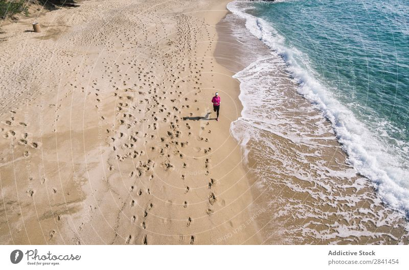 Photography aerial of woman doing running. Above Action Aircraft Athlete Beach Practice Woman Athletic Fitness Girl Healthy Jogger Jogging Lifestyle