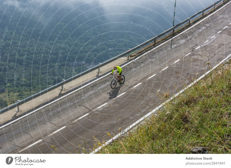 Cyclist in a mountain road Cycling Bicycle Cycle Street Practice Motorcycling Sports Nature Speed Adventure Healthy Action Summer Fitness Helmet Ride