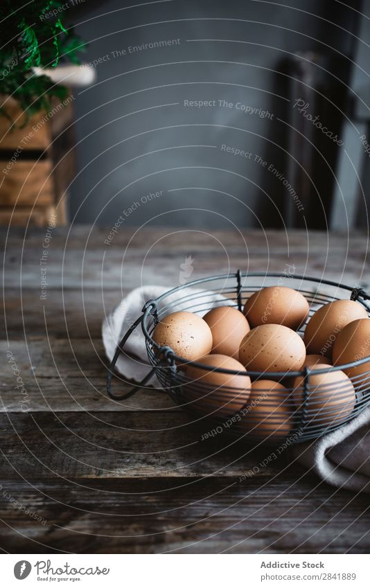 Eggs in net bowl Bowl Raw Food Ingredients Healthy Protein Breakfast Chicken Fresh Organic Eggshell Natural Fragile Cooking Net Wood Timber Kitchen Deserted Set