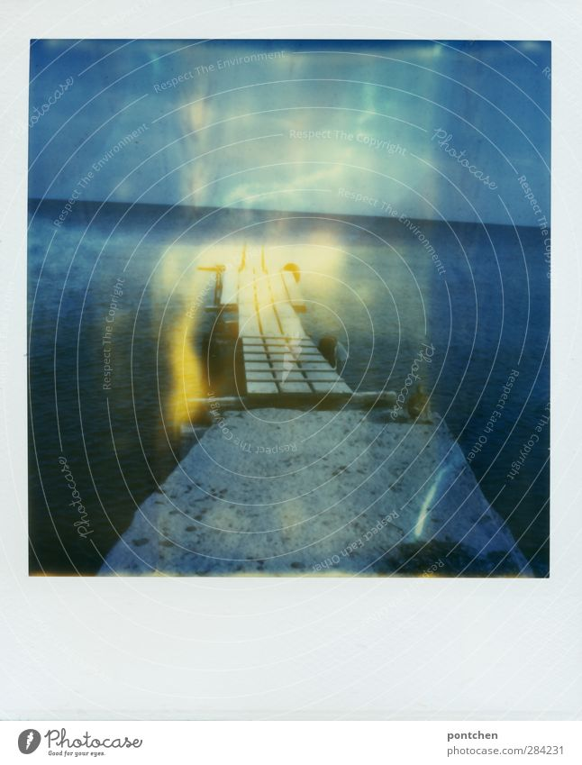 Polaroid. Wooden catwalk leads into the sea. Nature Water Sky Summer Coast Ocean Blue Footbridge Duck Tilt Colour photo Exterior shot Copy Space bottom Day