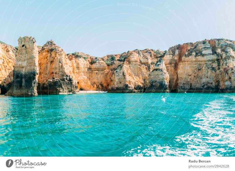 Ocean Landscape With Rocks And Cliffs At Lagos Bay Coast In Algarve, Portugal Nature Hole Cave Beach Stone Arch Window Vantage point Beautiful Vacation & Travel