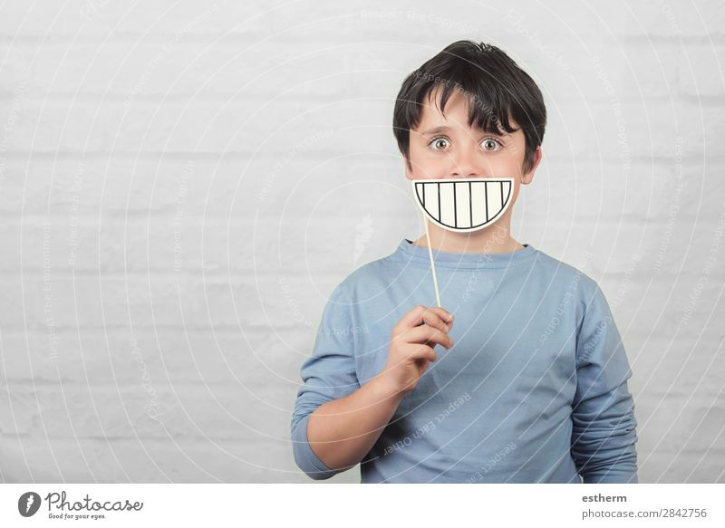 funny and smiling child with a cardboard smile Joy Playing Human being Masculine Child Infancy Teeth 1 8 - 13 years To hold on Fitness Smiling Laughter