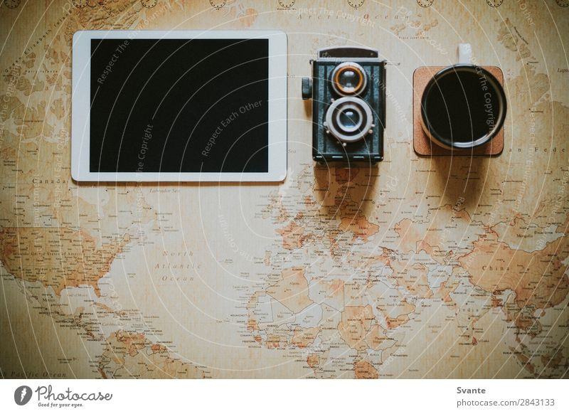 Top view of iPad on world map Vacation & Travel Lifestyle Style Earth Design Adventure Coffee Planning City trip Camera Map Vintage Analog Expedition