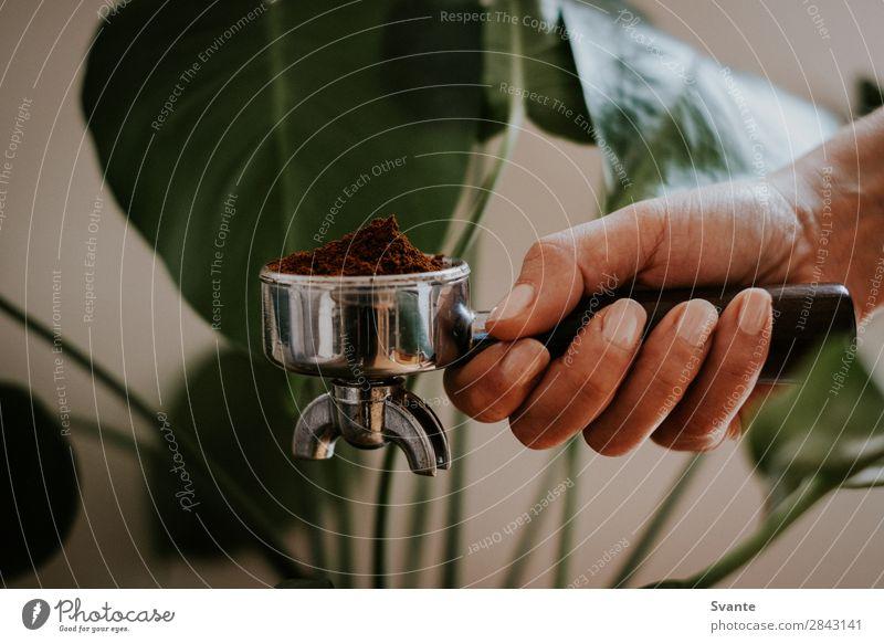 Side view of hand holding portafilter Coffee Lifestyle Hand Delicious Plant Portafilter Caffeine Hold Fresh Colour photo Interior shot