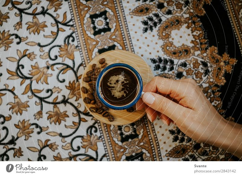 Woman holding coffee cup on floral pattern Human being Youth (Young adults) Young man Hand Lifestyle Interior design Style Design Esthetic Coffee Cup