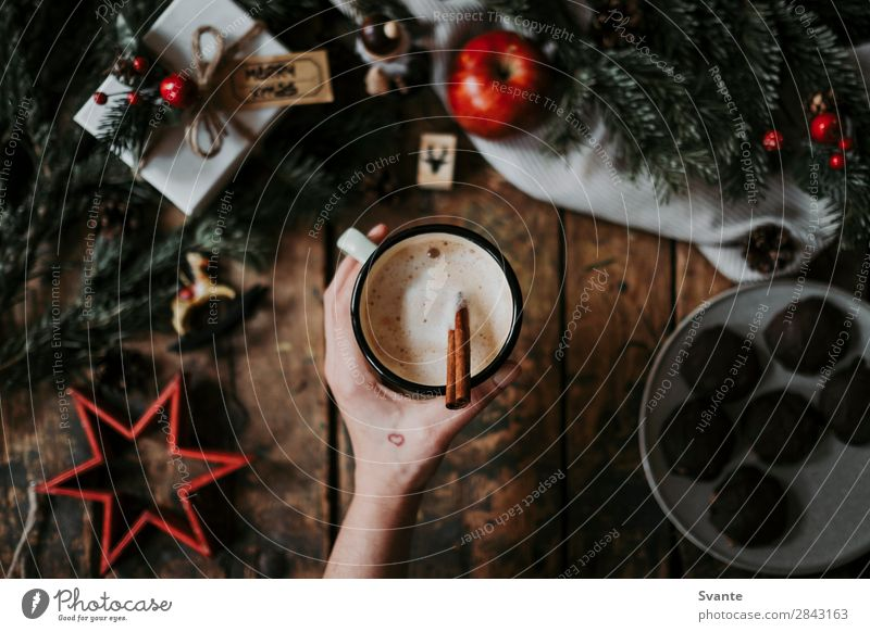 Top view of coffee cup and Christmas decoration Beverage Hot drink Hot Chocolate Coffee Latte macchiato Espresso Lifestyle Style Winter Woman Adults Hand 1