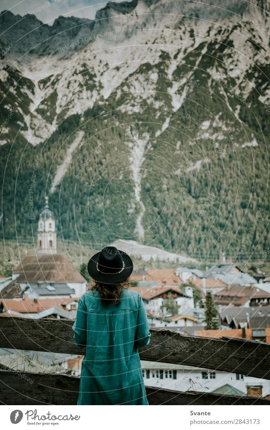 Woman in hat in front of mountain village Lifestyle Vacation & Travel Tourism Trip Adventure Mountain Hiking Human being Young woman Youth (Young adults) Adults