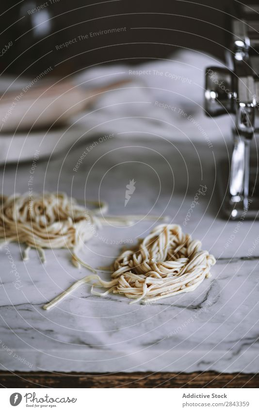 Raw pasta on marble background Pasta Accumulation Food Ingredients Meal Healthy Cooking Italian Wheat Diet Lunch Dinner Heap noodle Tradition Vegetarian diet