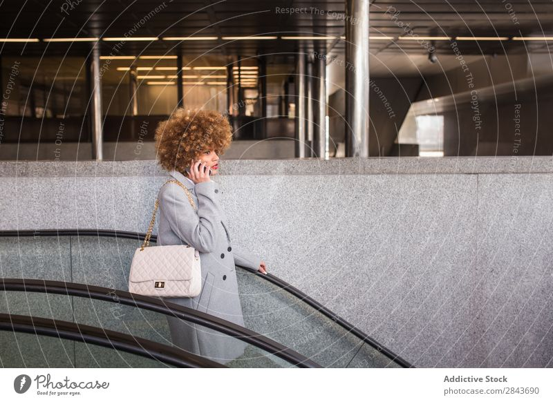 Stylish woman with phone on escalator Woman Style Adults pretty PDA To talk moving stairs Escalator downstairs Hair and hairstyles Blonde Ethnic Beautiful