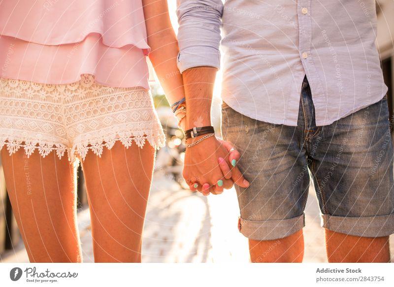 Closeup of couple holding hands Couple Embrace Street Portrait photograph lholding Hand Looking Passion Brunette handsome Beautiful Horizontal