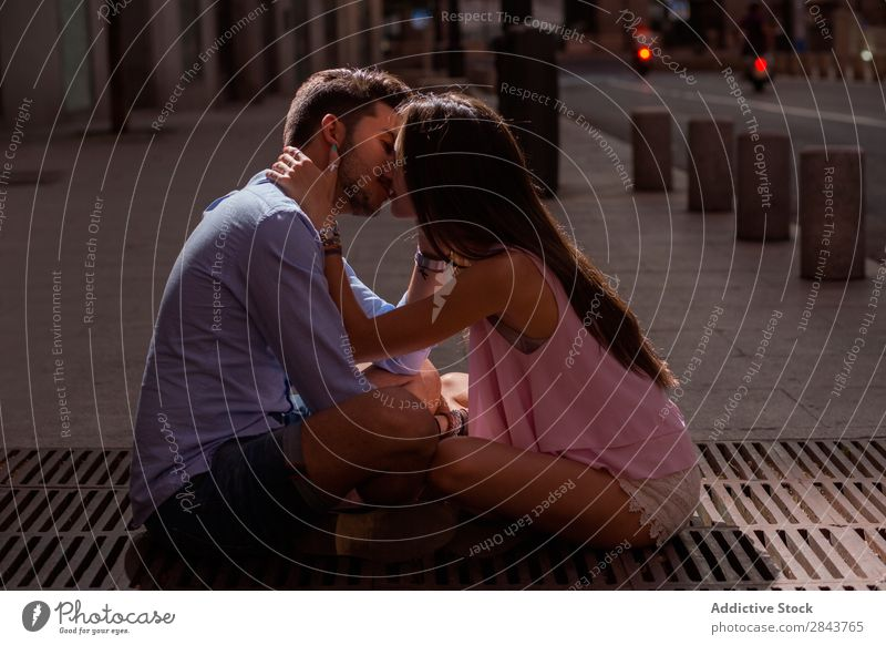 Portrait of beautiful couple in casual wear hugging in the street Couple Embrace Street Portrait photograph Looking into the camera Passion Kissing Brunette