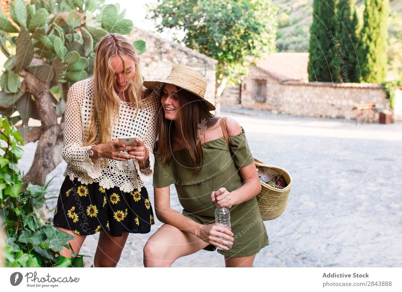 Women on town street Woman tourists Friendship Together Vacation & Travel Stand Town Street Posture Self-confident PDA browsing using Surfing Lifestyle