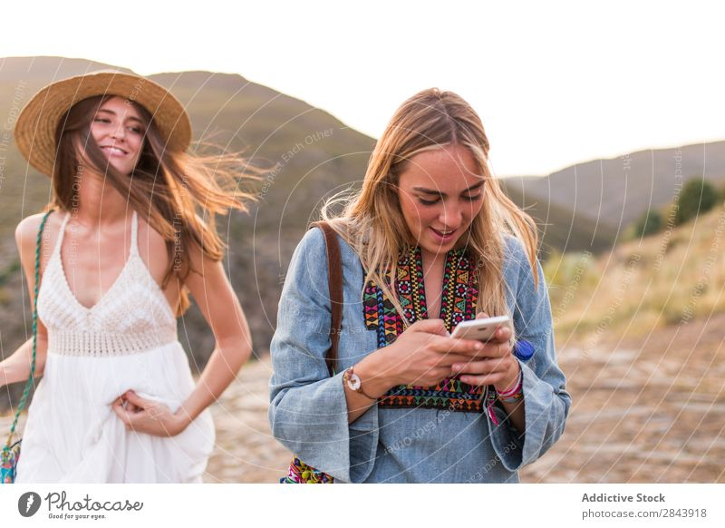 Women tourists with phone Woman Friendship Together shots Camera Photographer Vacation & Travel Lifestyle Youth (Young adults) Happy Tourism Human being Trip