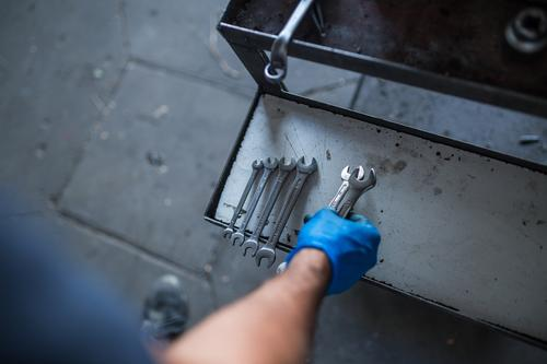 Mechanic tidying up tools Repair Employees & Colleagues wrench Organize sorting industrial Maintenance Workshop Industry Inspection Garage Fix Equipment