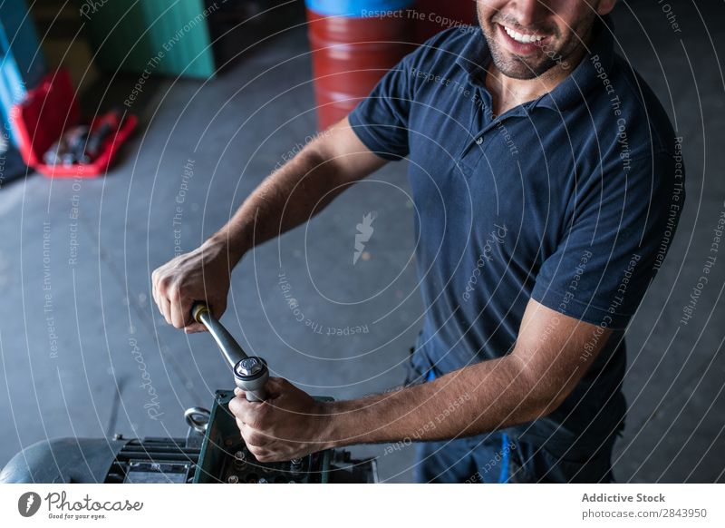 Mechanic fixing a compressor engine Repair Employees & Colleagues Industrial Engines disassembling wrench Bolt Maintenance Workshop Industry Inspection