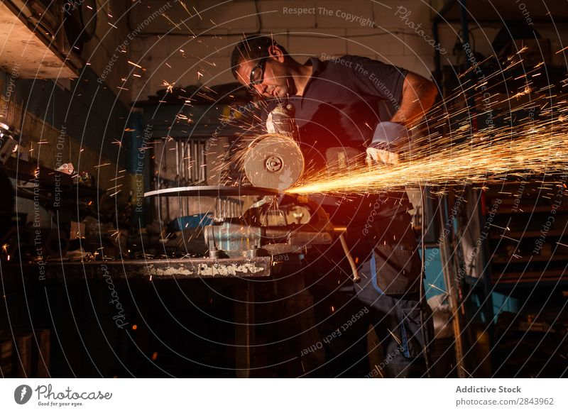 worker using an angle grinder Employees & Colleagues Metal Grinder Corner Spark Technology Power Industry Steel Industrial Tool Electric Factory Blade