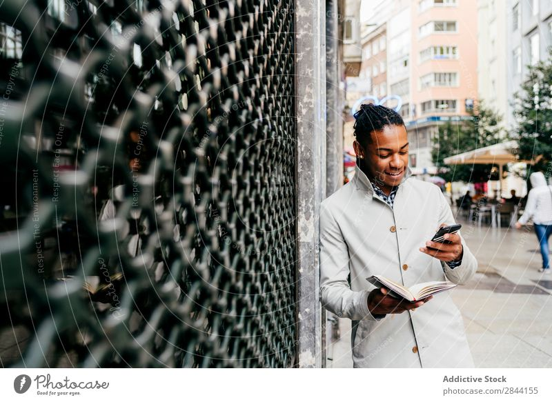 Black businessman talking phone at street Man Notebook Street Planning Lifestyle Technology Date Businessman To talk Easygoing Modern Smart occupation