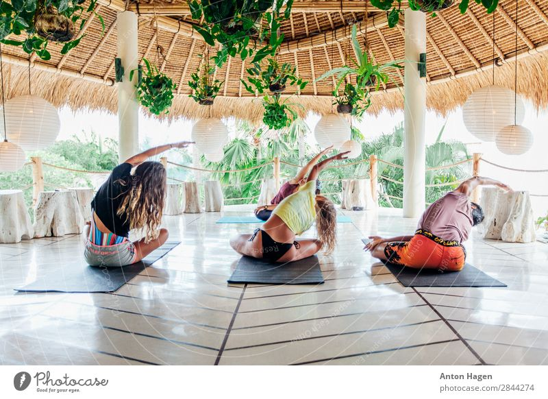 Group of young people practice yoga class at surf camp in Bali Lifestyle Healthy Athletic Fitness Wellness Meditation Vacation & Travel Summer Island Yoga