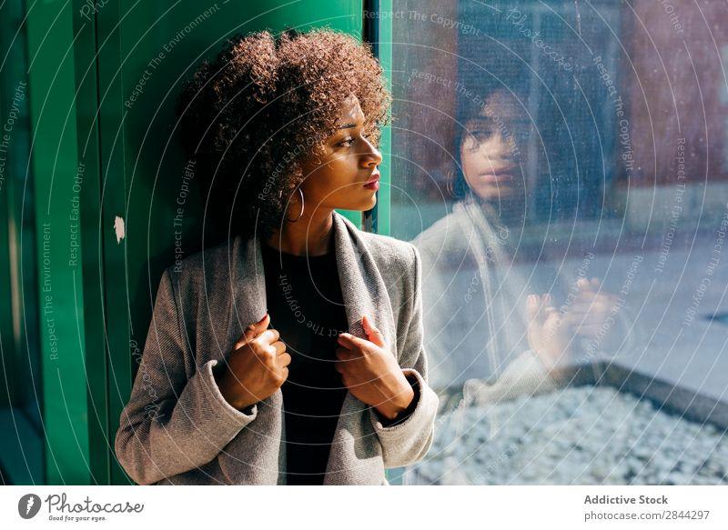 Trendy black model looking in window Woman Style Window Pensive To enjoy Feminine Elegant looking out African Beauty Photography Posture Street Bright Sunlight