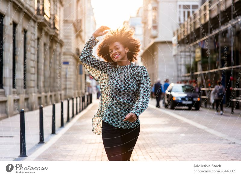 Cheerful ethnic woman walking at street Woman Happiness Dream Town Walking Success Style romantic Beauty Photography Street Feminine Posture Freedom Lifestyle