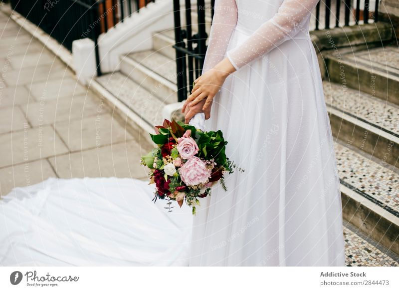 Unrecognizable woman with flowers in white dress Woman Bride Smock White Flower Bouquet Walking Veil