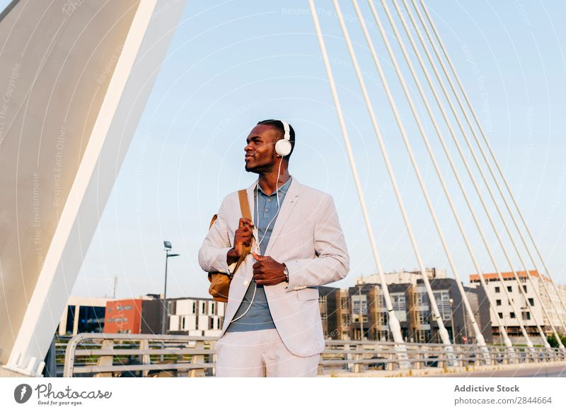 Stylish male model in suit with headphones Man Style Town Elegant Freedom Headphones Black Leisure and hobbies Modern Summer Technology Relaxation